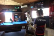 Easter Bunny supervises a pool game